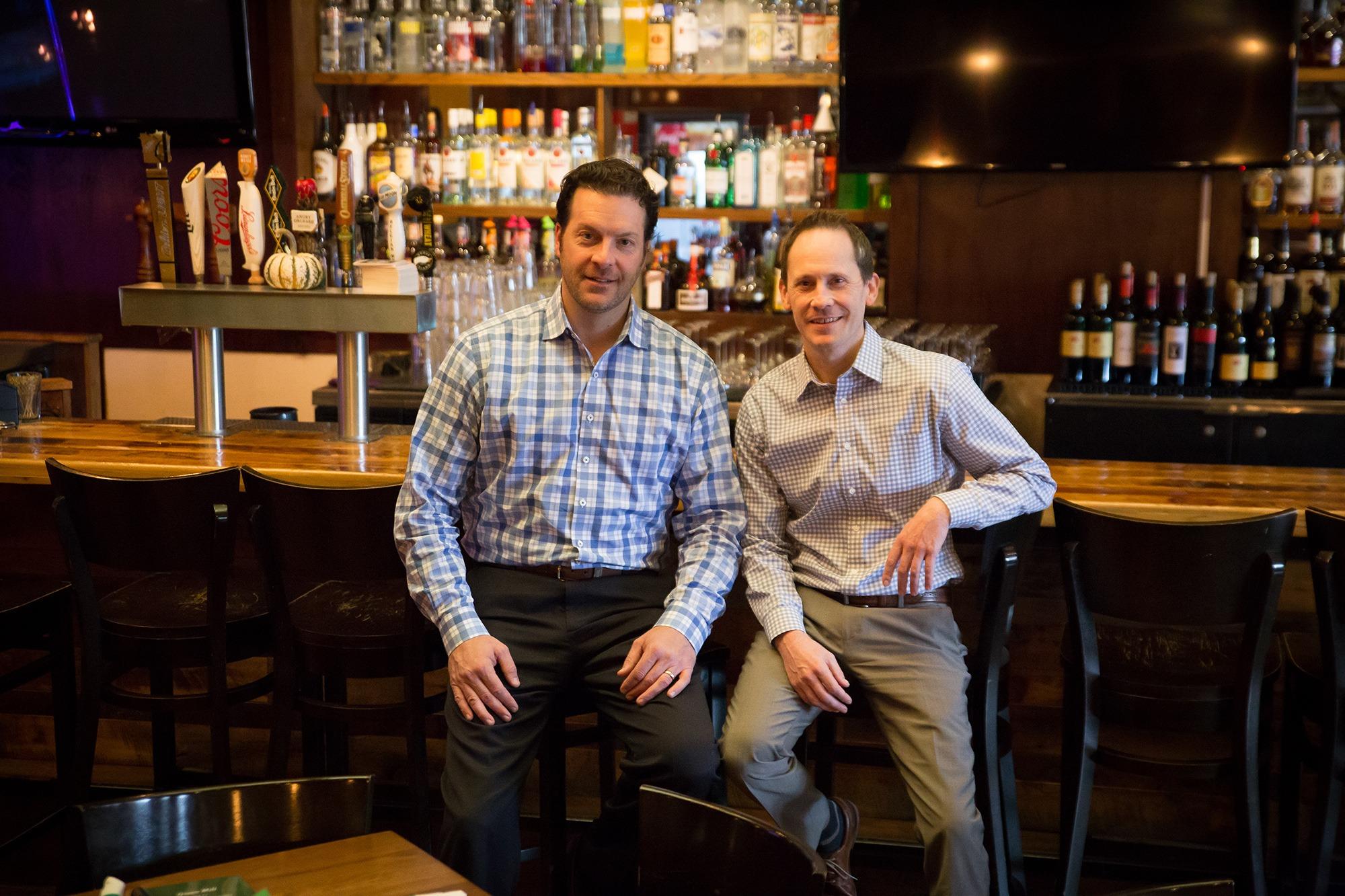 Image of: Paul Dzubnar, Hightop Hospitality Co-owner/Manager and Joe Bauer, Deerwood Bank Metro Market President.