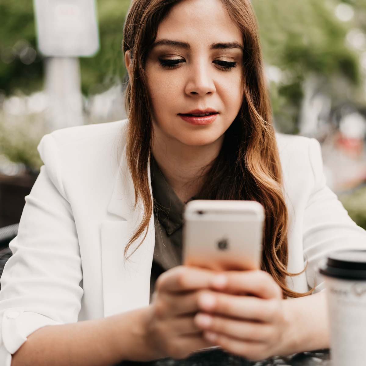 Young business women manages finances on her iphone
