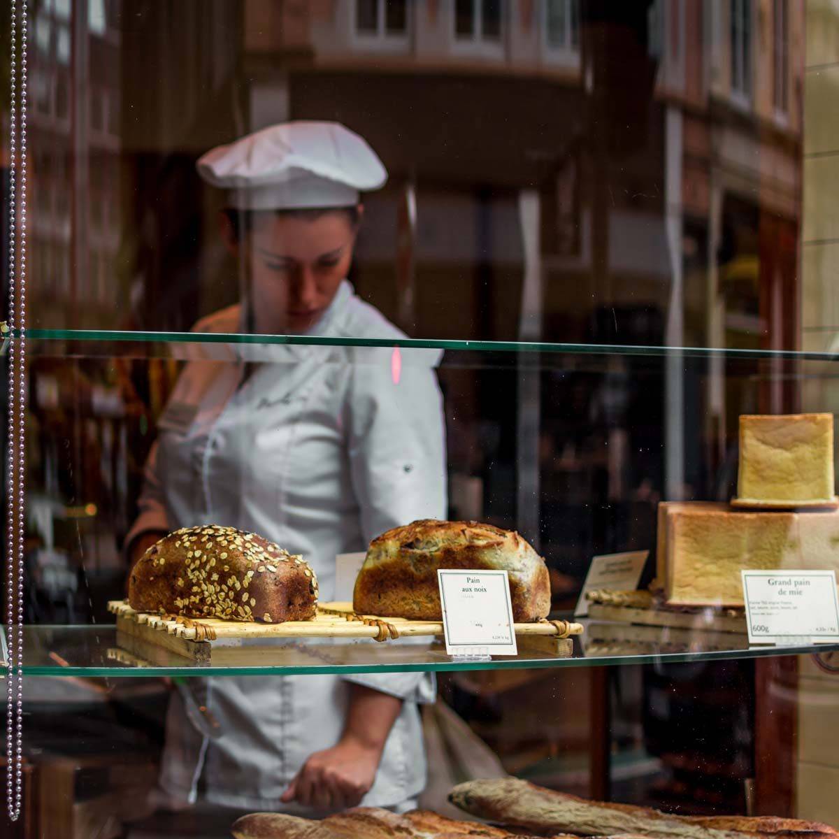 A business owner works in her bakery