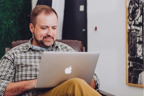 man on computer looking at is online banking